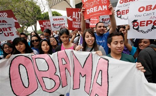 """Right to Dream"" students and supporters block the street outside the federal Metropolitan Detention Center Friday June 15, 2012, in Los Angeles to celebrate the Obama administrations decision to stop deporting younger illegal immigrants. (AP Photo)"
