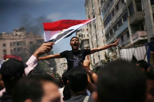 An Egyptian protester chants slogans against presidential candidate Ahmed Safiq during a demonstration against the Supreme Constitutional Court rulings in Alexandria, Egypt, June 15, 2012. (AP Photo/Manu Brabo)