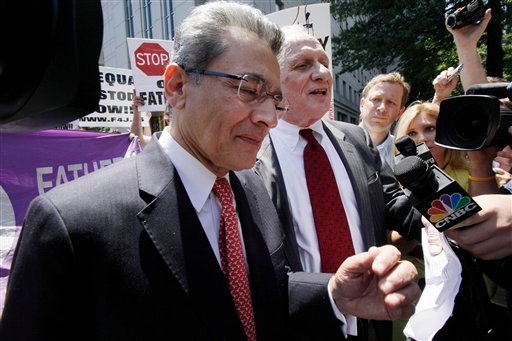 Former Goldman Sachs director Rajat Gupta, left, and his attorney Gary P. Naftalis, leave federal court in New York, Friday, June 15, 2012. (AP Photo/Richard Drew)