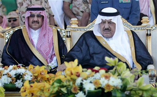 In this Tuesday, Nov. 1, 2011 file photo, Saudi's Crown Prince - Interior minister Nayef bin Abdul-Aziz, right, and his son, deputy to the Saudi Interior Minister, Prince Mohammed bin Nayef, attend a ceremony of the Saudi armed forces, as they prepare for
