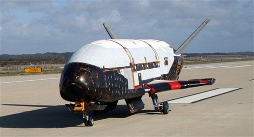 This undated file image provided by the U.S. Air Force shows the X-37B spacecraft. The unmanned Air Force space plane steered itself to a landing early Saturday, June 16, 2012, at a California military base, capping a 15-month clandestine mission. (AP)