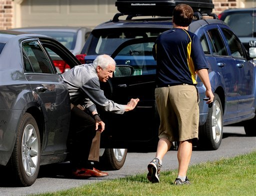 Jerry Sandusky gets out of his Attorney Karl Rominger's car, Sunday, June 17, 2012, in Lemont, Pa. (AP Photo/Centre Daily Times, Abby Drey)