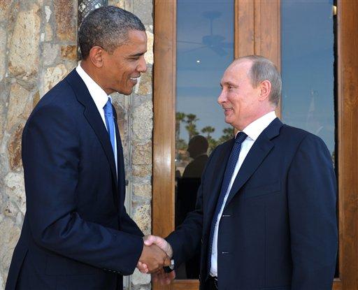 U.S. President Barack Obama, left, greets Russia's President Vladimir Putin at the G-20 Summit in Los Cabos, Mexico, Monday, June 18, 2012. (AP Photo/RIA-Novosti, Alexei Nikolsky, Presidential Press Service)