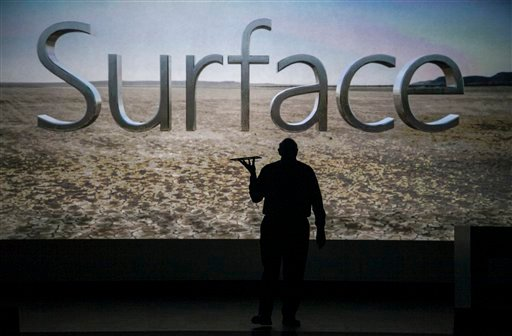 """Microsoft CEO Steve Ballmer unveils """"Surface"""", a new tablet computer to compete with Apple's iPad at Hollywood's Milk Studios in Los Angeles Monday, June 18, 2012. (AP Photo/Damian Dovarganes)"""