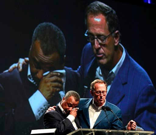 Fred Luter, Pastor of the Franklin Ave. Baptist Church in New Orleans, right, wipes away tears as he is elected as president of the Southern Baptist Convention, at the convention in New Orleans, Tuesday, June 19, 2012. (AP Photo/Gerald Herbert)