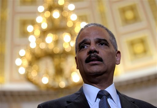 Attorney General Eric holder speaks to reporters following his meeting on Capitol Hill in Washington, Tuesday, June 19, 2012 (AP Photo/Susan Walsh)