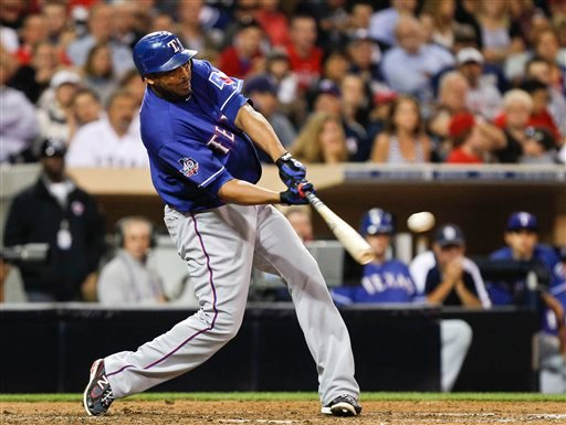 Texas Rangers' Nelson Cruz rips a two run double to left field against the San Diego Padres during the sixth inning of an interleague baseball game Tuesday, June 19, 2012 in San Diego. (AP Photo/Lenny Ignelzi)