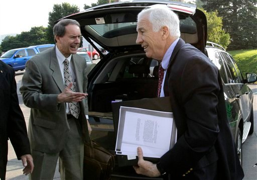 Former Penn State University assistant football coach Jerry Sandusky, right, arrives with his attorney Joe Amendola at the Centre County Courthouse in Bellefonte, Pa., Wednesday, June 20, 2012. (AP Photo/Gene J. Puskar)