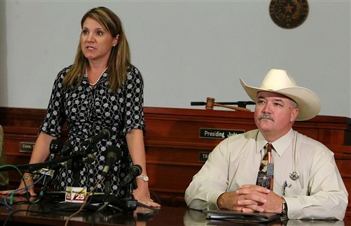 25th Judicial District Attorney Heather McMinn, left, and Lavaca County Sheriff Mica Harmon appear at a news conference in Halletsville, Texas on Tuesday, June 19, 2012. (AP Photo/San Antonio Express-News, Kin Man Hui)
