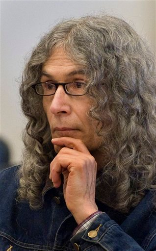 In this March 30, 2010 file photo, convicted serial killer Rodney Alcala listens as victim-impact statements are read in a Santa Ana, Calif. Alcala has been on death row in California for the 1970s stranglings of five people. (AP Photo/Michael Goulding)