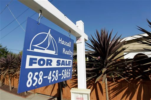 FILE-This June 13, 2012, file photo, shows a house for sale in San Diego. (AP Photo/Gregory Bull, File)