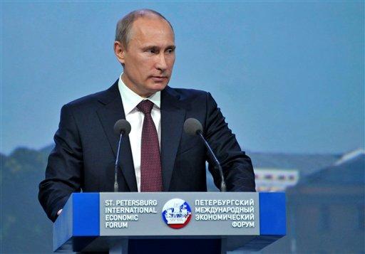 Russian President Vladimir Putin speaks at the economic forum in St. Petersburg, Russia, Thursday, June 21, 2012. (AP Photo/RIA-Novosti, Alexei Nikolsky, Presidential Press Service)