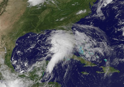 This NOAA satellite image taken Saturday, June 23, 2012, shows shower and thunderstorm activity developing around an area of low pressure spinning in the Gulf of Mexico. (AP Photo/NOAA)