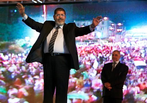 May 20, 2012 file photo, the Muslim Brotherhood's presidential candidate Mohammed Morsi hold a rally in Cairo, Egypt. Egypt's electoral commission announced Sunday, June 24, 2012 that Morsi is victor of landmark presidential vote.(AP Photo/Fredrik Persson