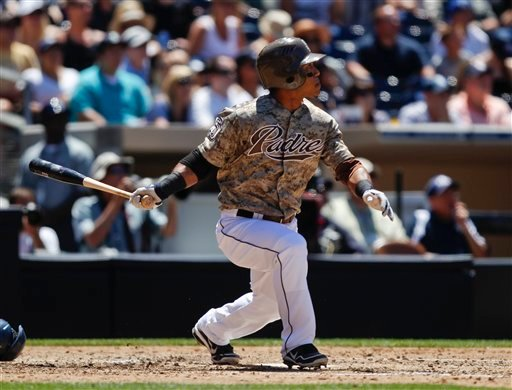 San Diego Padres' Alexi Amarista watches his two-run double sail over the head of the Seattle Mariners' left fielder during the fourth inning of an interleague baseball game on Sunday, June 24, 2012, in San Diego. (AP Photo/Lenny Ignelzi)