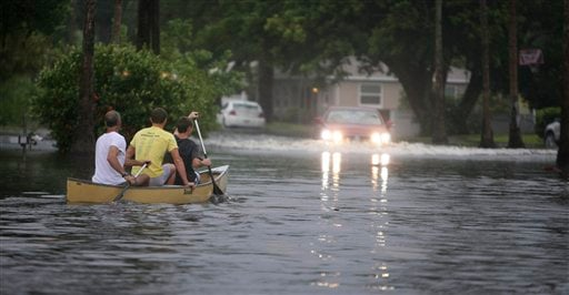 Canoe-goers navigate flooded streets as flooding continues to worsen and Tropical Storm Debby pounds the Tampa Bay, Fla., area Sunday, June 24, 2012. (AP Photo/Tampa Bay Tribune, Chris Zuppa)