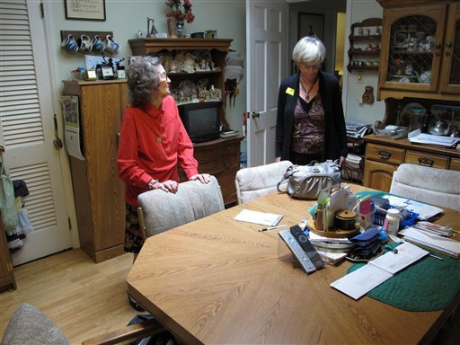 In this Thursday, April 19, 2012 photo, Miriam Parker, left, talks with her daughter, Donna, at the table in the kitchen of the Raleigh, N.C., home where she and her husband raised their four children.