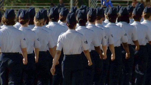 In this June 22, 2012, image made from video, female airmen march during graduation at Lackland Air Force Base in San Antonio. (AP Photo/John L. Mone)