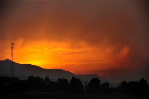 The sun sets as seen from Lower Gold Camp Road as a wildfire continues to burn west of Colorado Springs, Colo. on Sunday, June 24, 2012. (AP Photo/The Colorado Springs Gazette, Susannah Kay)