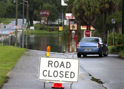 A closure sign is displayed due to floodwaters on Silver Springs Boulevard, Monday, June 25, 2012, in Salt Springs, Fla. (AP Photo/The Ocala Star-Banner, Alan Youngblood)