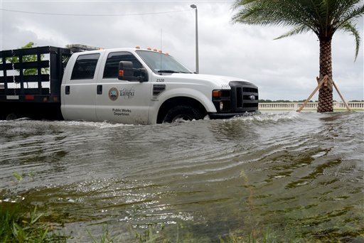 A City of Tampa truck makes it's way down a flooded Bayshore Blvd. on Monday, June 25 2012. (AP Photo/Tampa Tribune, Paul Lamison)