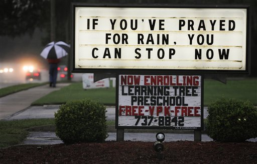 A message referring to rainfall from a tropical storm system is displayed at the San Jose Baptist Church on Monday, June 25, 2012, in Jacksonville, Fla. (AP Photo/The Florida Times-Union, Kelly Jordan)