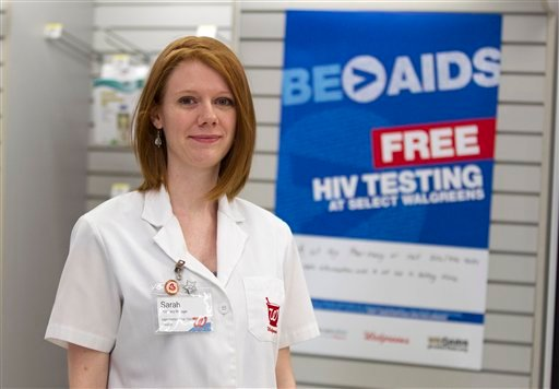 Walgreen's pharmacy manager Sarah Freedman stands in her store in Washington, Tuesday, June 26, 2012.  (AP Photo/Evan Vucci)