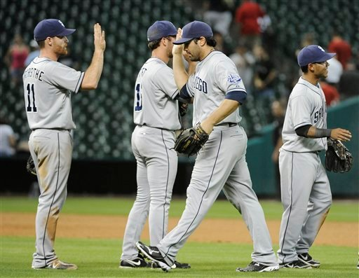 The San Diego Padres celebrate an 8-7 win over the Houston Astros in 10 innings in a baseball game Monday, June 25, 2012, in Houston. (AP Photo/Pat Sullivan)