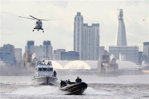 In this Thursday, Jan. 19, 2012 file photo security forces take part during in a combined British police and British Royal Marines security exercise for the London 2012 Olympic Games on the River Thames in London. (AP Photo/Alastair Grant, File)