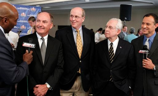 Big Ten Commissioner Jim Delany, second from left, BCS executive director Bill Hancock, center, and SEC Commissioner Mike Slive, second from right, smile during an interview after a BCS presidential oversight committee meeting and media availability.