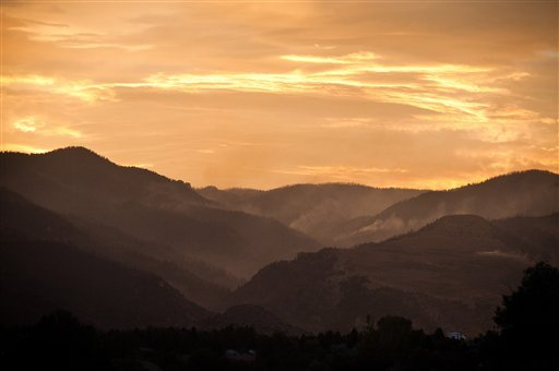 Light smoke is visible in Queen's Canyon as the sun sets on the fifth day of the Waldo Canyon Fire burning west of Colorado Springs, Colo. Wednesday, June 27, 2012.  (AP Photo/The Colorado Springs Gazette,Mark Reis )