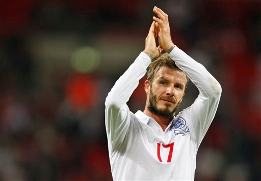 FILE This Wednesday, Oct. 14, 2009 file photo shows England's David Beckham applauding the crowd after their World Cup group 6 qualifying soccer match against Belarus at Wembley Stadium, London. (AP Photo/Kirsty Wigglesworth)