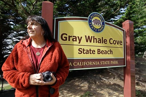 File - In this Feb. 21, 2012 file photo, Lucy D'Mot poses at Gray Whale Cove State Beach near Pacifica, Calif. (AP Photo/Paul Sakuma, File)