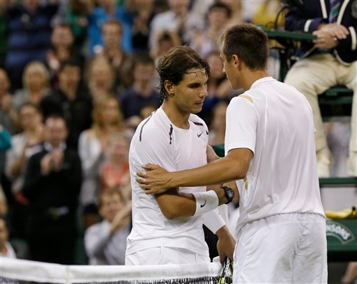 Lukas Rosol, right, of the Czech Republic is congratulated by Rafael Nadal of Spain after Rosol defeated Nadal in a second round men's singles match at the All England Lawn Tennis Championships at Wimbledon June 28, 2012. (AP Photo/Anja Niedringhaus)