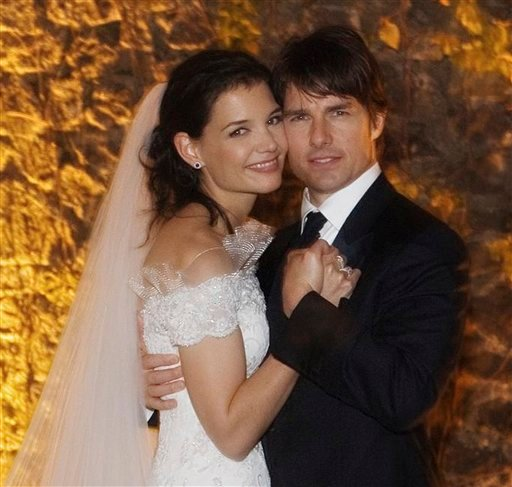 FILE - In this Nov. 18, 2006 file photo released by Rogers and Cowan, actor Tom Cruise and actress Katie Holmes pose in their wedding attire at the 15th-century Odescalchi Castle overlooking Lake Bracciano outside of Rome.