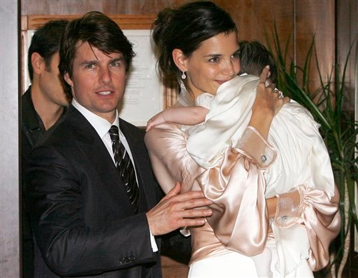 FILE - In this Nov. 17, 2006 file photo, U.S. actor Tom Cruise, and U.S. actress Katie Holmes with their daughter Suri, who became engaged in June 2005, leave a restaurant in Rome.