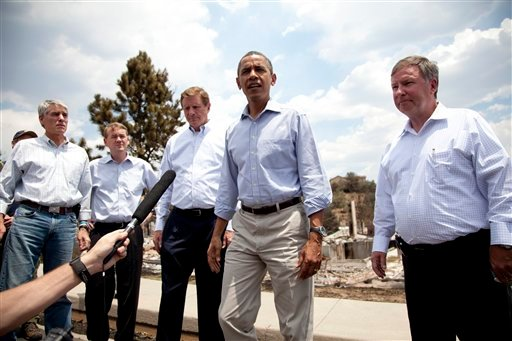 President Barack Obama talks with media as he tours the Mountain Shadow neighborhood devastated by wildfires, Friday, June 29, 2012, in, Colorado Springs, Colo. (AP Photo/Carolyn Kaster)