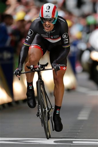 Fabian Cancellara of Switzerland strains as he crosses the finish line to win the prologue of the Tour de France cycling race. (AP Photo/Laurent Rebours)