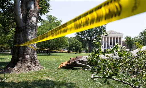 An American Beech tree is down on Capitol Hill grounds in Washington Saturday, June 30, 2012 across the U.S. Supreme Court after a powerful storm swept across the Washington region late Friday. (AP Photo/Manuel Balce Ceneta)