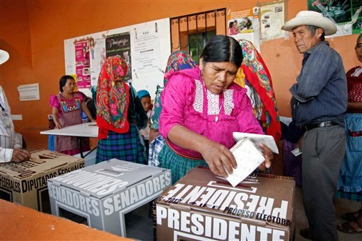 A woman casts her ballot at a polling station in Oaxaca, Mexico, Sunday, July 1, 2012. (AP Photo/ Luis Alberto Cruz)