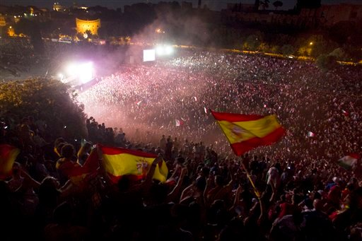 Spanish soccer fans celebrate their victory against Italy in the Euro 2012 final in Rome, Sunday, July 1, 2012. (AP Photo/Angelo Carconi)
