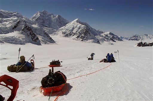 Members of Warfighter Sports Denali Challenge pull gear while attempting to climb Mount McKinley in Alaska. The five men descended Alaska's Mount McKinley on Monday, July 2. (AP Photo/Disabled Sports USA, File)