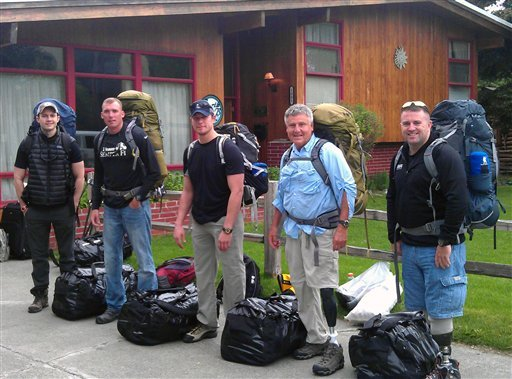 Jesse Acosta, from left, David Borden, Neil Duncan, Kirk Bauer and Steve Martin, members of Warfighter Sports Denali Challenge, pose for a photograph in Anchorage, Alaska on June 11, 2012. (AP Photo/Disabled Sports USA, File)