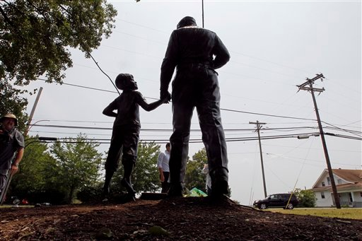 A statue of Andy and Opie Taylor is shown outside the Andy Griffith Playhouse in Mount Airy, N.C., Tuesday, July 3, 2012. Andy Griffith, the iconic actor and North Carolina native died Tuesday at the age of 86. (AP Photo/Gerry Broome)