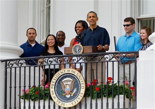 President Barack Obama speaks from the the Balcony of the White House as he and first lady Michelle Obama start an Independence Day celebration with a barbecue, concert and a view of fireworks, Wednesday, July 4, 2012, on the South Lawn of the White House