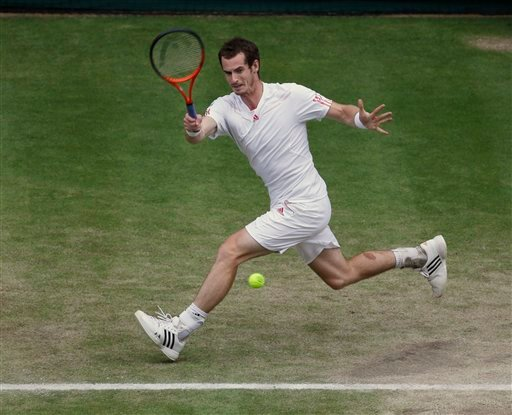 Andy Murray of Britain plays a return to David Ferrer of Spain during a quarterfinals match at the All England Lawn Tennis Championships at Wimbledon, England, Wednesday, July 4, 2012. (AP Photo/Alastair Grant)