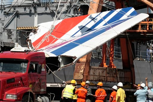 In this Sunday, June 14, 2009 file photo shows workers unloading debris, belonging to crashed Air France flight AF447, from the Brazilian Navy's Constitution Frigate in the port of Recife, northeast of Brazil.