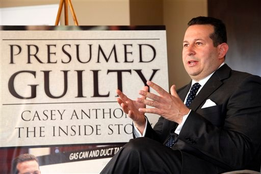 In this Tuesday, July 3, 2012 photo, Casey Anthony's defense attorney, Jose Baez, gestures as he speaks during an interview with The Associated Press in Coral Gables, Fla.