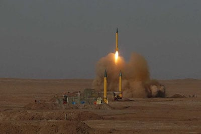 In this picture released by the Iranian Fars News Agency, a surface-to-surface missile is launched during the Iranian Revolutionary Guards maneuver in an undisclosed location in Iran. (July 3, 2012)