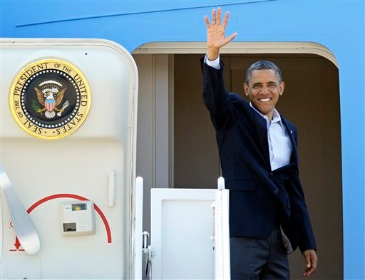 President Barack Obama waves as he boards Air Force One, for a flight to Ohio, Thursday, July 5, 2012, at Andrews Air Force Base, Md. (AP Photo/Cliff Owen)